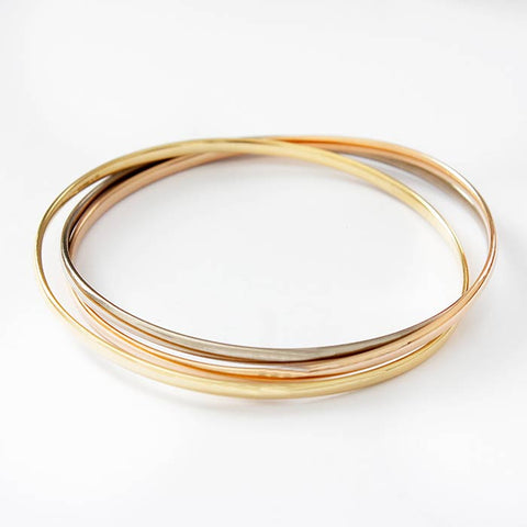 a secondhand 18 carat gold 3 colour solid russian design bangle with hallmark