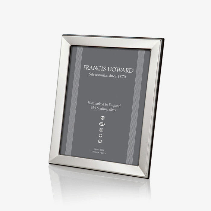 silver photo frame made in sheffield with a bevelled edge and wooden black finish