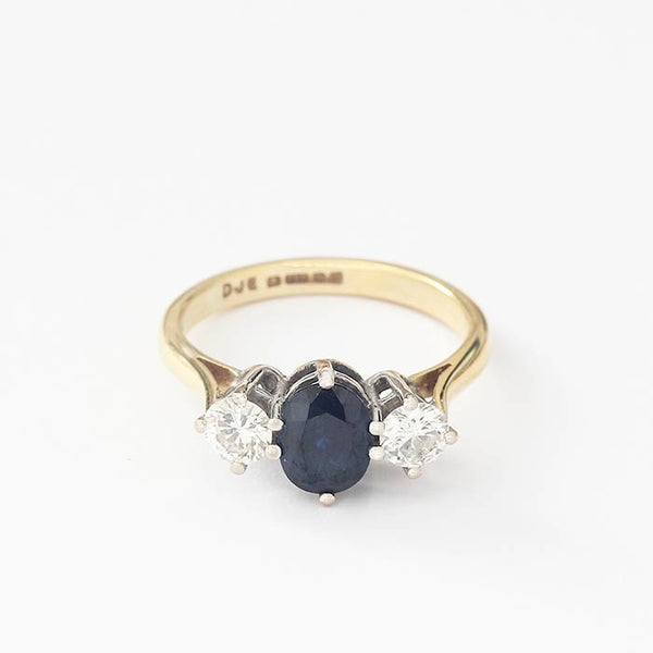 a 3 stone oval sapphire and diamond ring in yellow gold and white gold