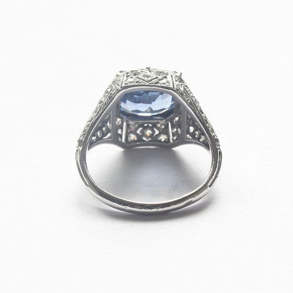 a secondhand platinum sapphire and diamond cluster ring with an Art Deco design