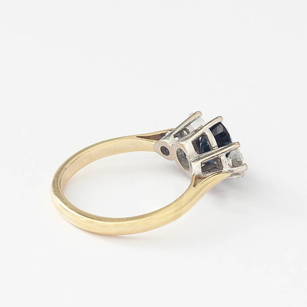 a yellow and white gold sapphire and diamond 3 stone ring with claw settings