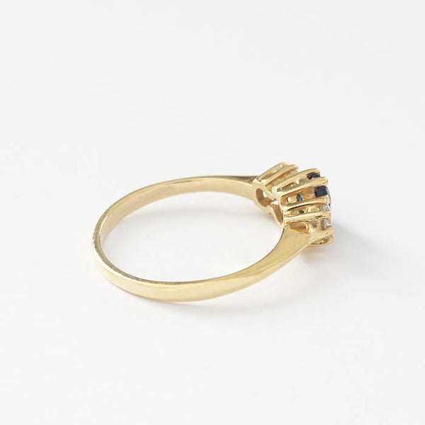 a secondhand yellow gold claw set sapphire and diamond 3 stone ring