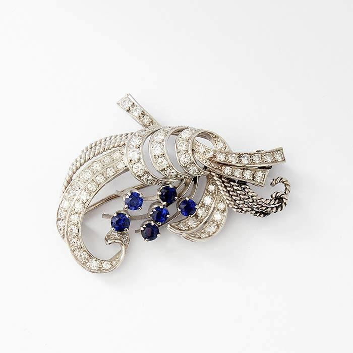 a beautiful sapphire and diamond floral design white gold brooch