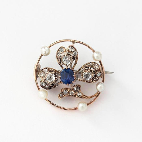 a beautiful sapphire diamond and pearl clover leaf shaped rose gold secondhand brooch