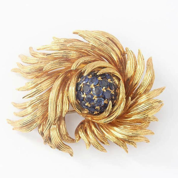 a tiffany and co yellow gold 18 carat brooch with a cluster of round sapphires floral design