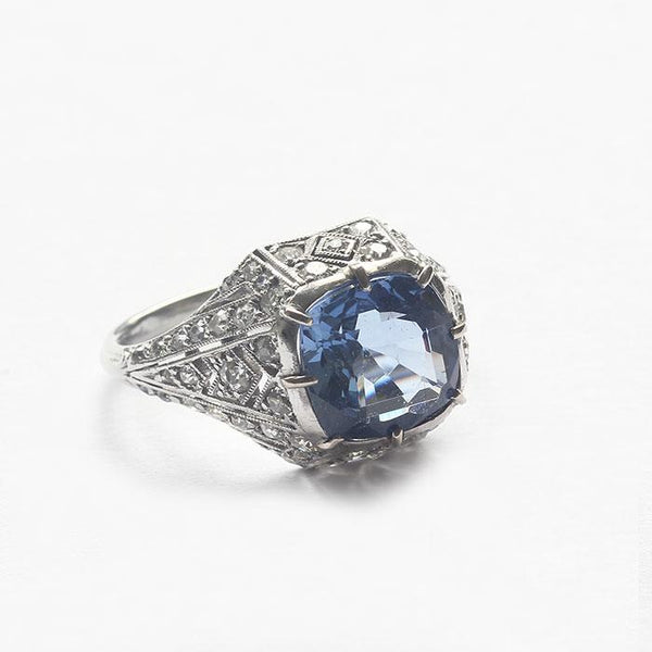 a French Art Deco sapphire and diamond cluster ring in platinum