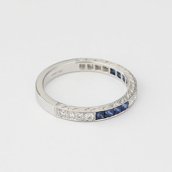 white gold sapphire and diamond eternity ring in a grain setting