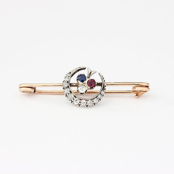sapphire ruby and diamond brooch in yellow gold crescent shaped in centre dated 1912
