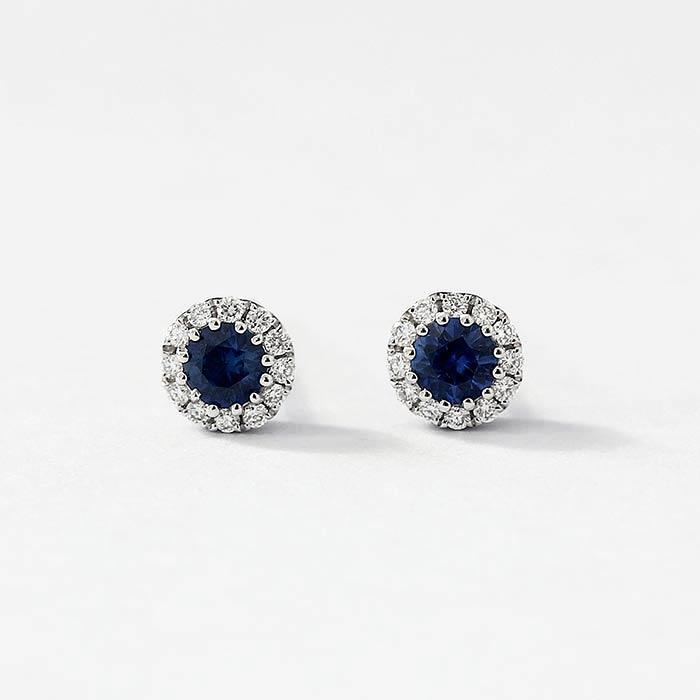 sapphire and diamond cluster stud earrings in a white gold setting with a post and butterfly