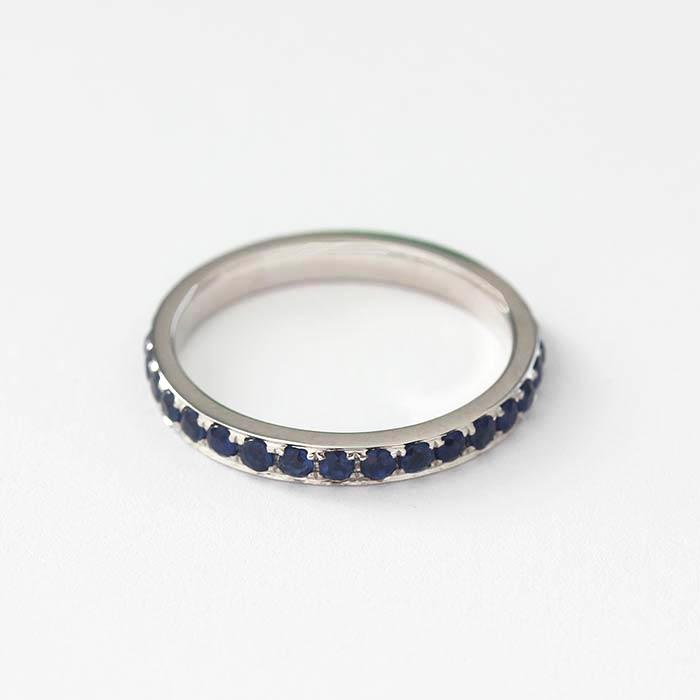 a full eternity ring in 18 carat white gold with 31 round faceted sapphire stones