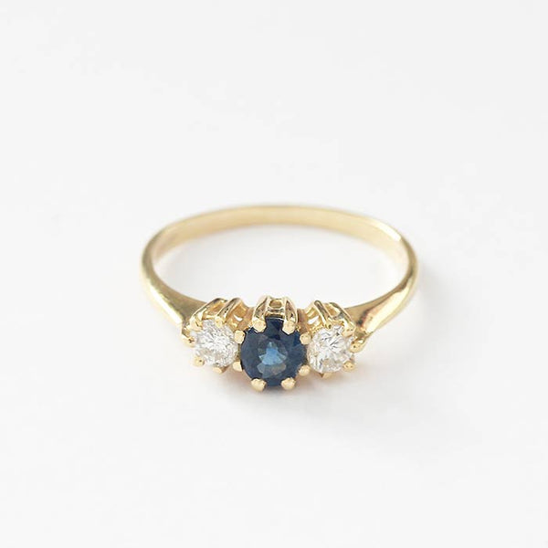 a secondhand sapphire and diamond 3 stone ring in yellow gold with claw settings