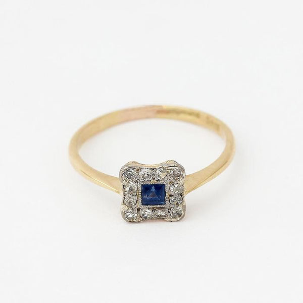 a secondhand vintage sapphire and diamond cluster ring in a square shape in yellow gold