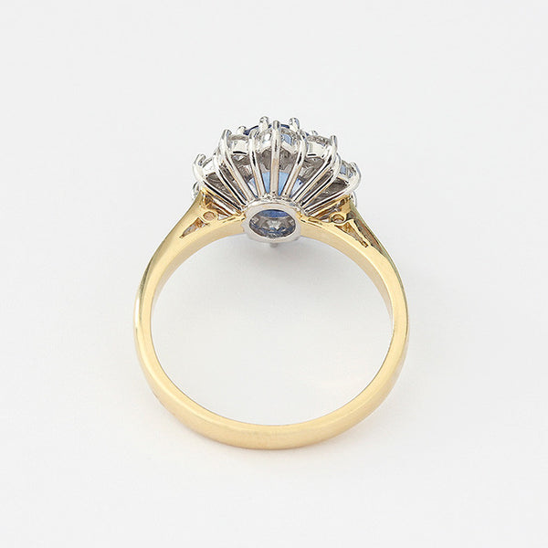 sapphire and diamond cluster ring in a claw setting in 18ct gold