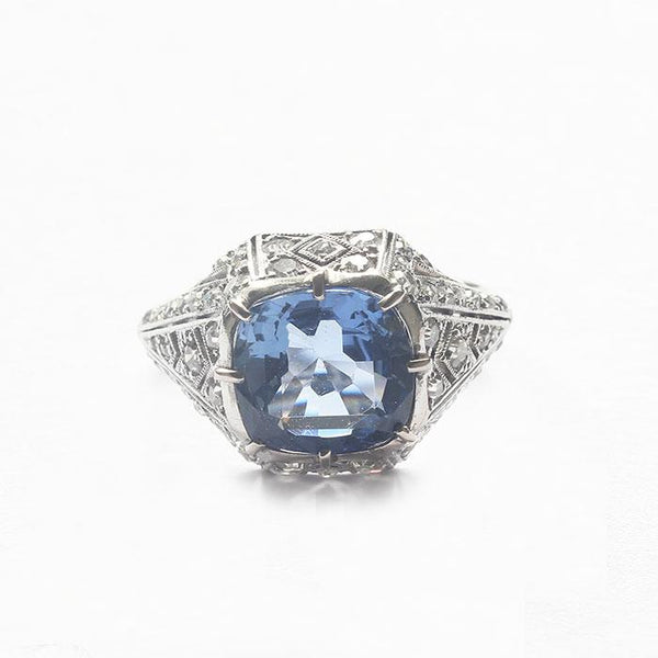 a beautiful sapphire diamond cluster ring in platinum Art Deco design French