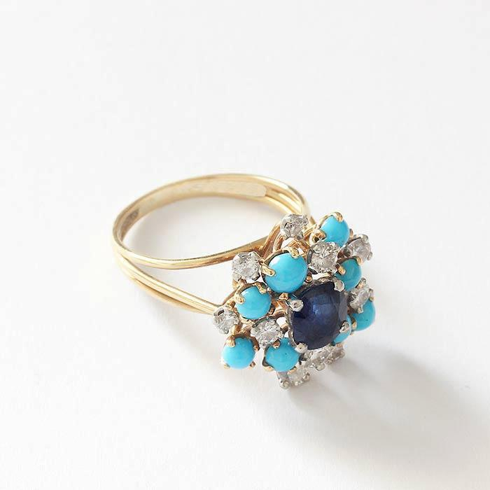 a sapphire turquoise and diamond cluster cocktail ring in yellow gold with claw settings vintage design