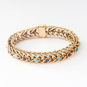 a beautiful sapphire and turquoise gold bracelet with a round curb link and box clasp