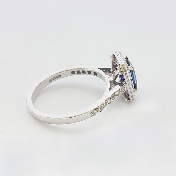 a white gold sapphire and diamond set cluster ring