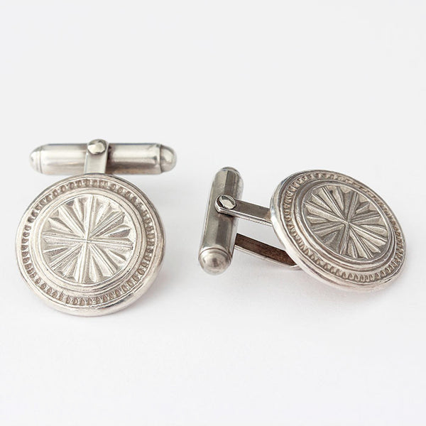 silver wheel design cufflinks with a satin finish