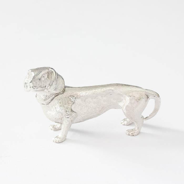 a solid silver dachshund dog figure collectable with collar