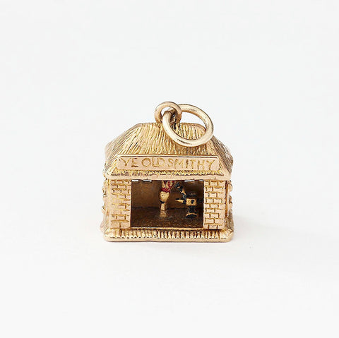 yellow gold blacksmith charm with enamel