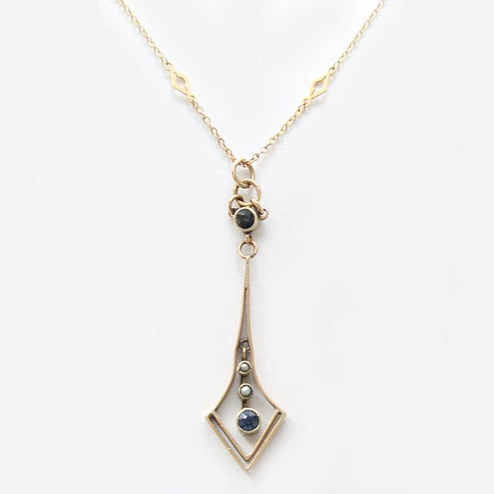 a beautiful seed pearl and sapphire elegant drop pendant and chain in yellow gold