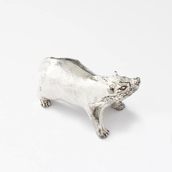 a fine quality sterling silver badger ornament which is solid and british made with hallmark