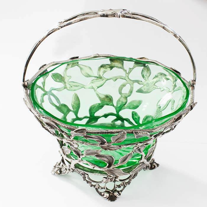 a beautiful antique sterling silver small swing handled basket with a floral pattern and a green glass plain insert all hallmarked
