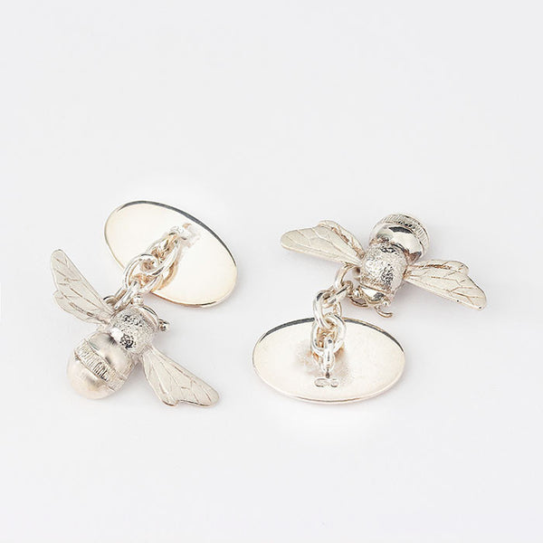 solid silver bee cufflinks with yellow enamel honeycomb