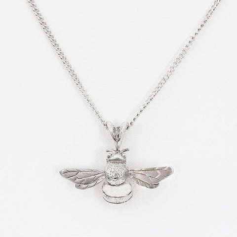 silver bee pendant with a curb link necklace