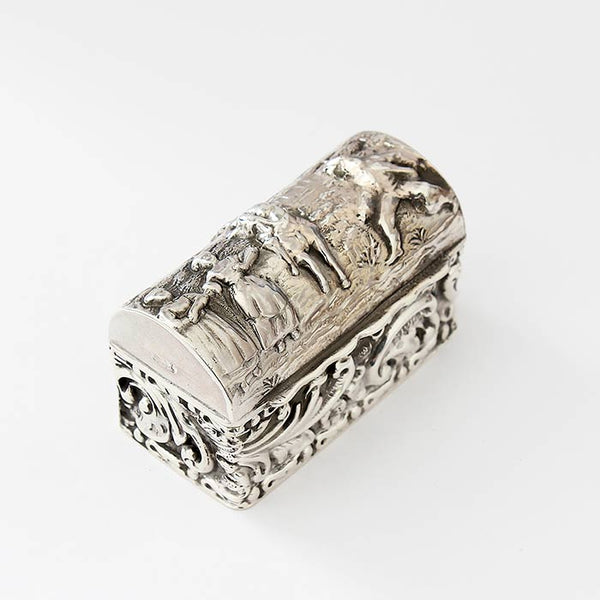an antique embossed little ring box in silver with room for 3 rings engraving with figures and buildings outside