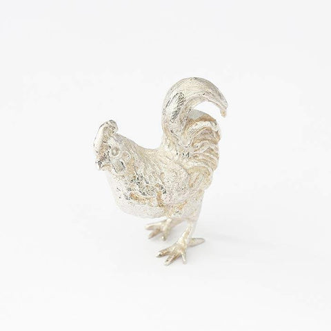 a solid silver cockerel figure with a full british hallmark