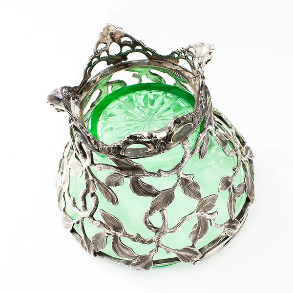 a beautiful antique sterling silver small swing handled basket with a floral pattern and a green glass plain insert
