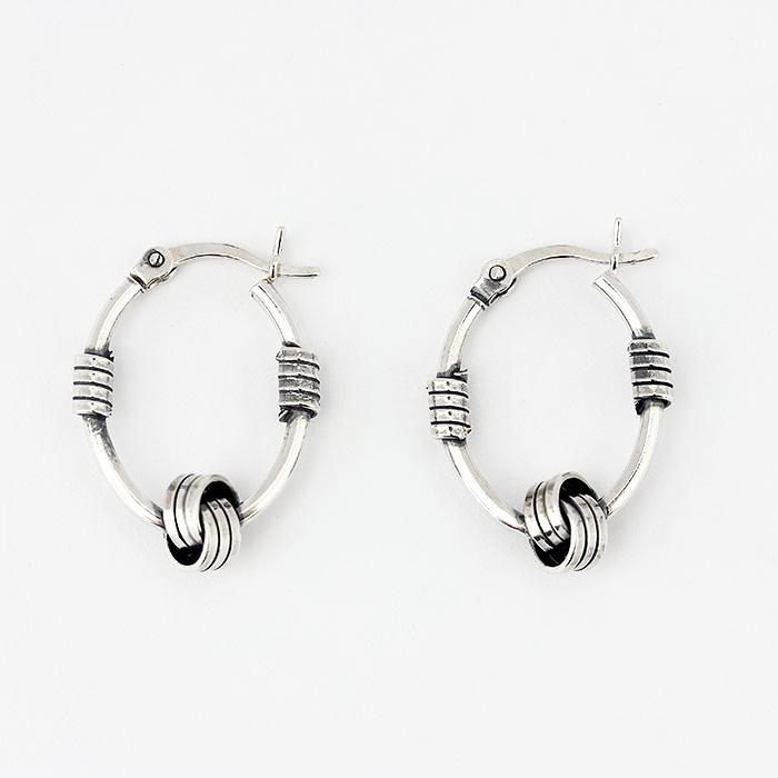 silver oval hoops with a knot design pattern and hook fittings
