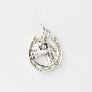 silver horse shoe and horse head charm