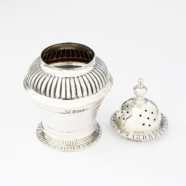 a silver pepper shaker with ribbed design hallmarked sheffield 1885