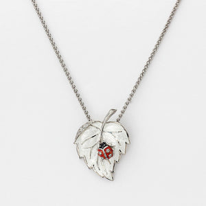 silver ladybird necklace with leaf pendant and enamel