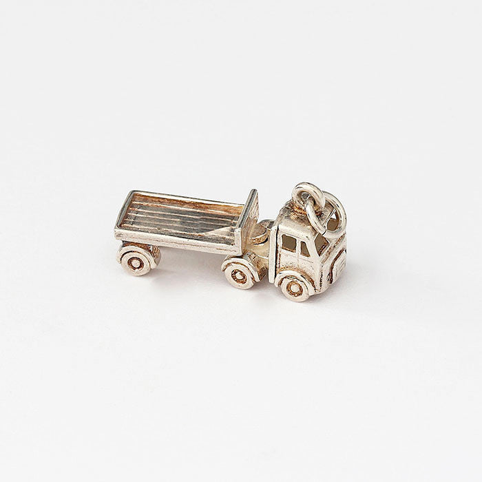 silver moving truck charm