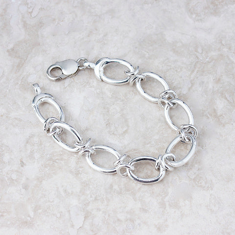 silver oval link bracelet with strong clasp solid in weight