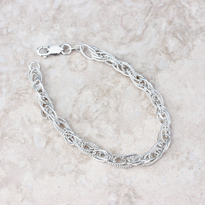 silver triple link design bracelet with strong clasp contemporary style