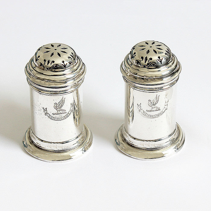 a georgian style pair of silver britannia peppers with a family crest and motto