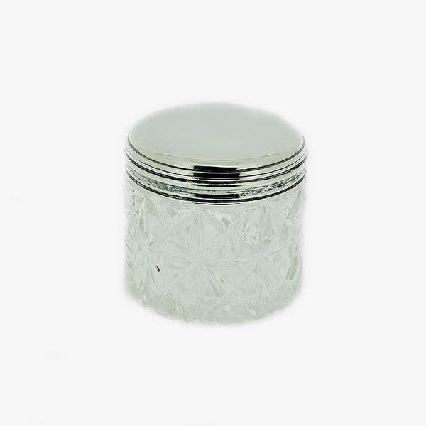 a silver and glass small round pot with patterned glass and plain top and hallmark