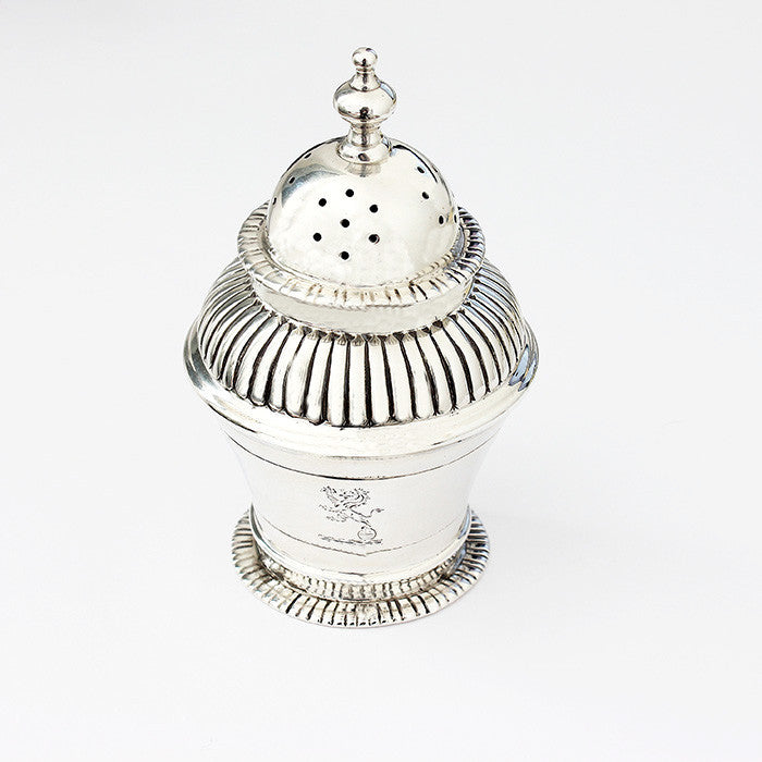 a secondhand silver pepper shaker dated 1885 and lion motif