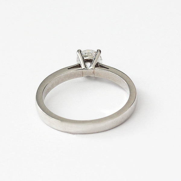 a classic round diamond engagement ring in platinum with claw setting