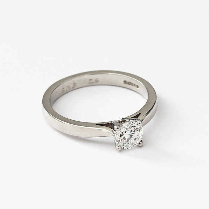 a platinum diamond engagement ring with 4 claw setting
