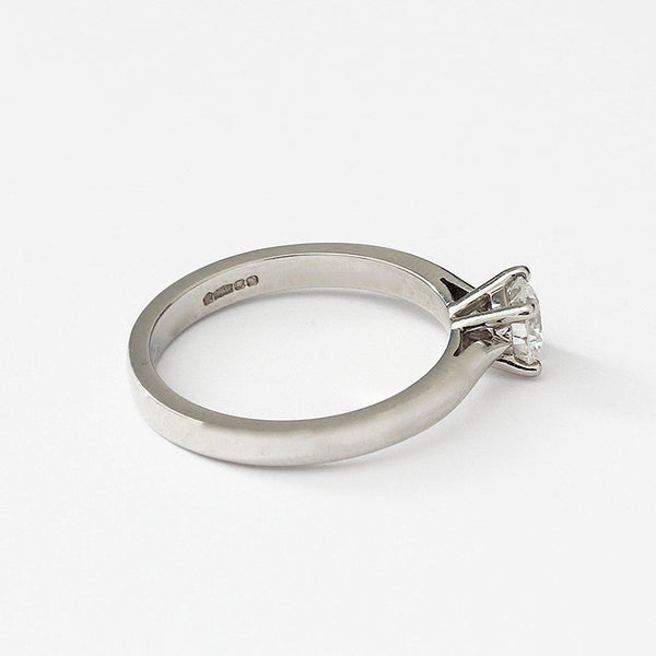 a diamond single stone engagement ring in platinum with a 4 claw setting