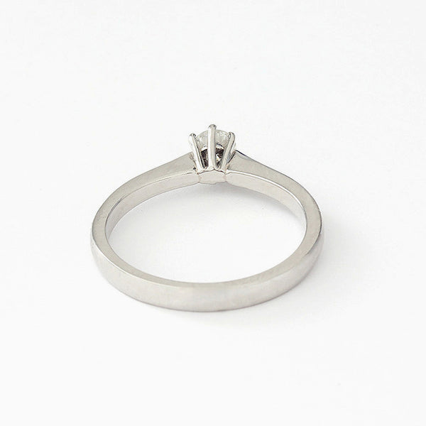 a single round diamond ring in platinum with 6 claws