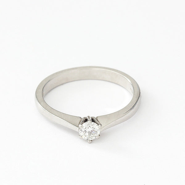 a round diamond ring set in platinum with 6 claws