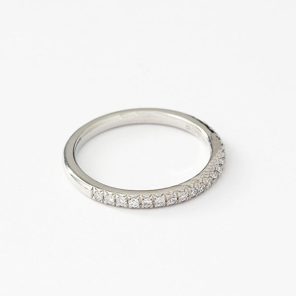 a diamond half eternity ring in platinum with 20 stones in a channel