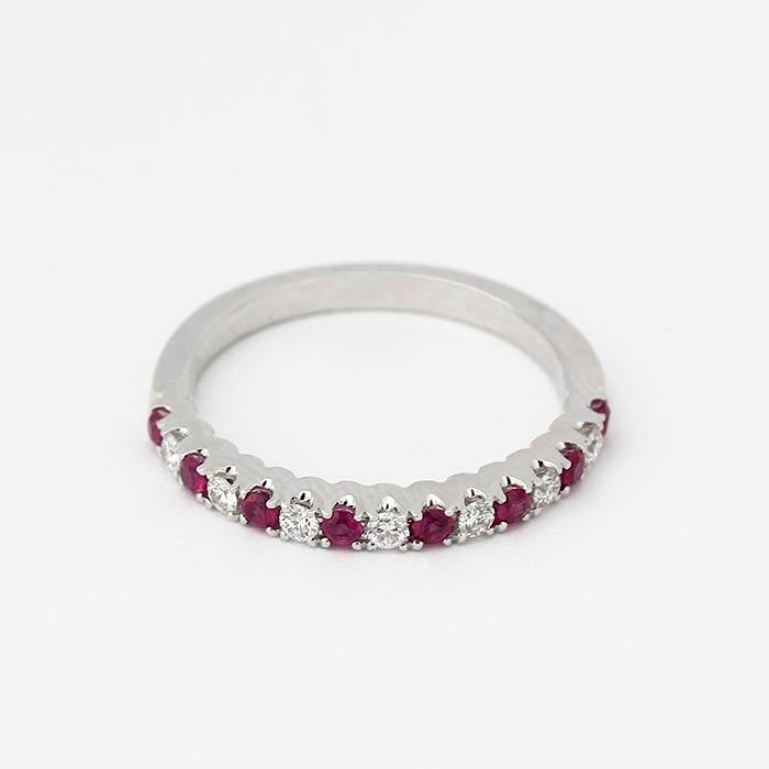an elegant ruby and diamond half eternity ring in white gold with 8 rubies and 7 diamonds