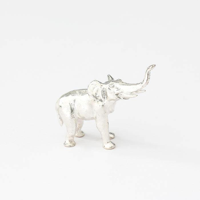 a small silver elephant figure all british made